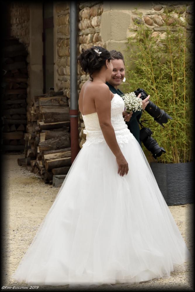 La photographe et sa mariée